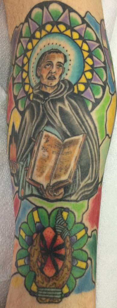 Stained glass leg sleeve featuring the Patron Saint of Plumbers