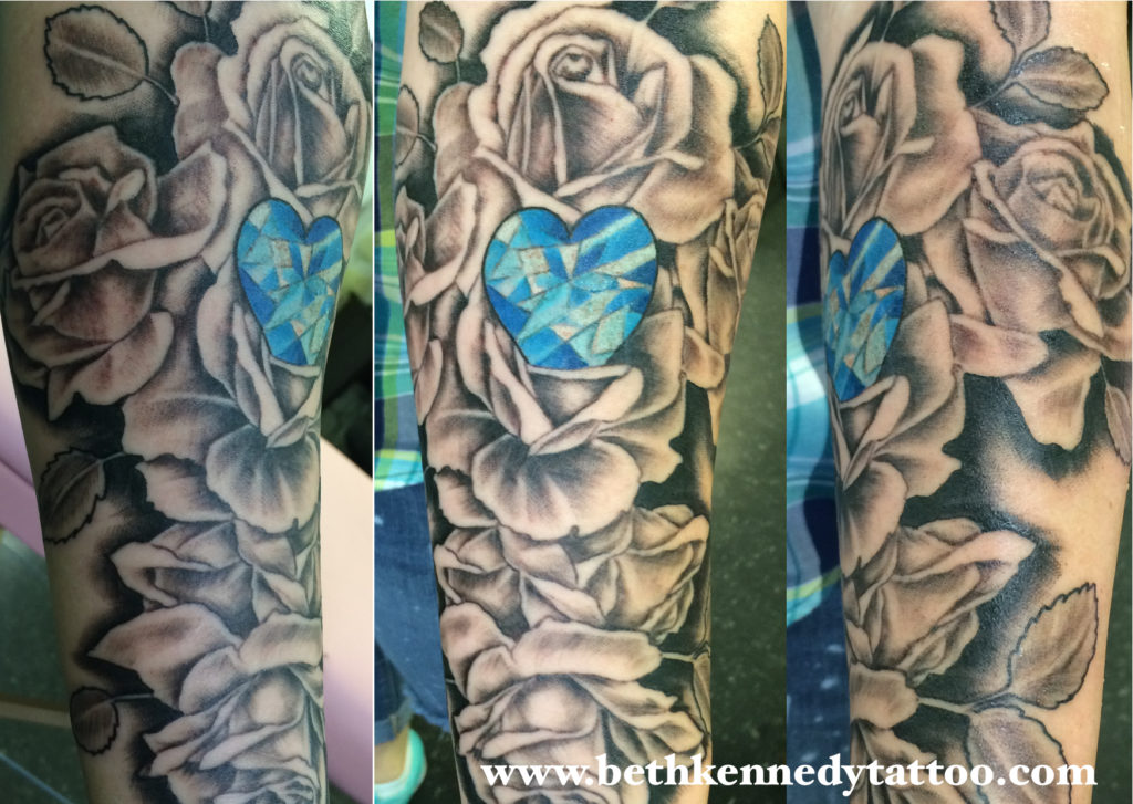 black and grey roses with blue heart shaped jewel